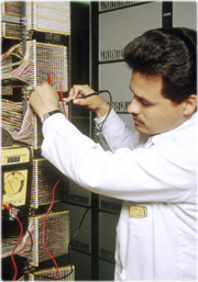Emilio in a telephone connections room